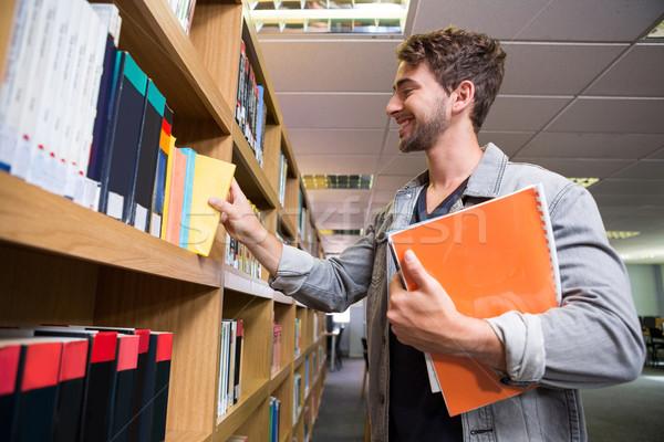 Studente libro shelf biblioteca Università Foto d'archivio © wavebreak_media