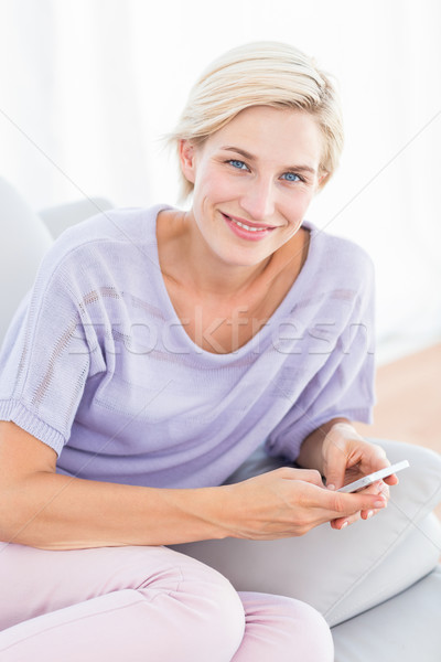 Pretty blonde woman texting with her mobile phone  Stock photo © wavebreak_media