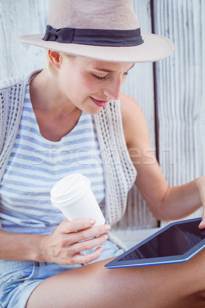 Pretty blonde woman using her tablet and holding goblet Stock photo © wavebreak_media