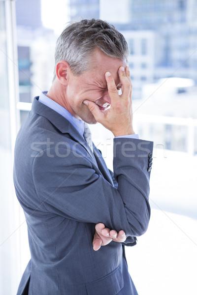 Problémás üzletember tart fej iroda öltöny Stock fotó © wavebreak_media