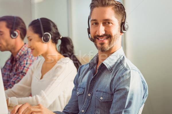 улыбаясь бизнесмен рабочих портрет коллеги Сток-фото © wavebreak_media