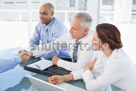 Serious business people speaking at meeting Stock photo © wavebreak_media