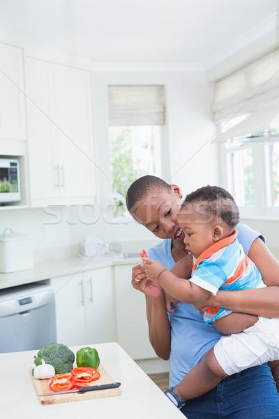 Happy smiling mother with his babyboy Stock photo © wavebreak_media
