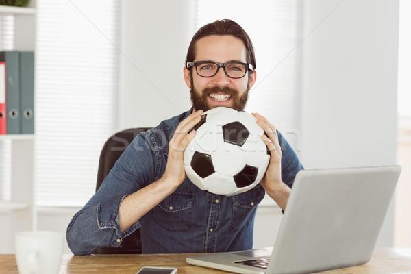 Hipster businessman holding a football Stock photo © wavebreak_media