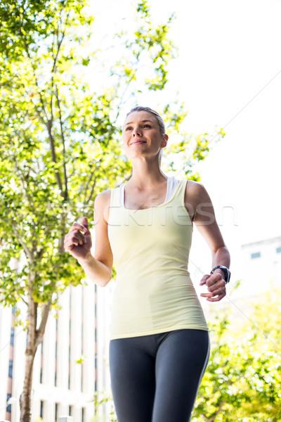 A pretty woman running in the street  Stock photo © wavebreak_media
