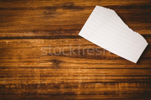 Scrap of paper on wooden table Stock photo © wavebreak_media