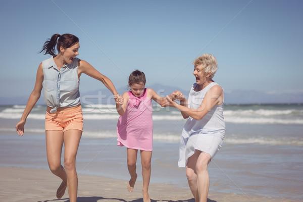 Happy multi-generation family playing at beach Stock photo © wavebreak_media