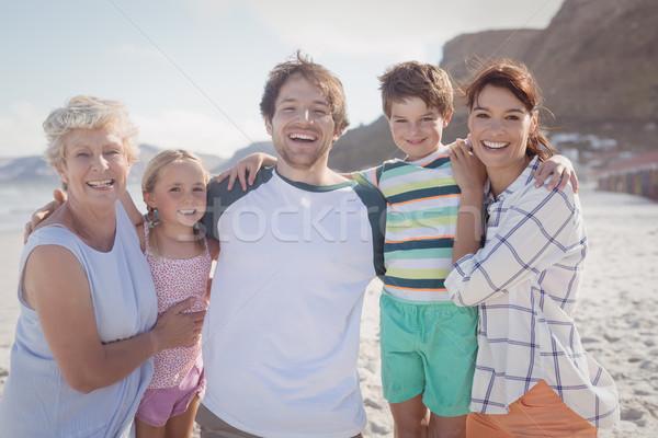Portrait of multi-generated family embracing at beach Stock photo © wavebreak_media