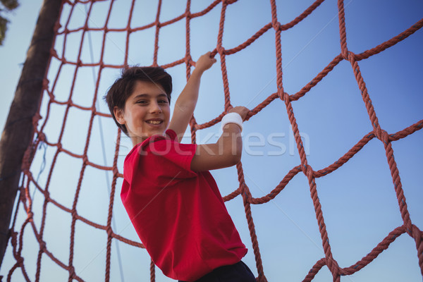 Boy climbing a net during obstacle course training Stock photo © wavebreak_media