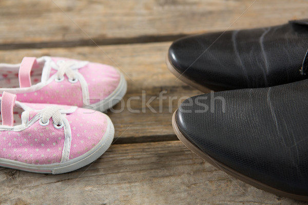 Cropped image of leather and canvas shoes Stock photo © wavebreak_media