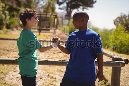 Feliz amigo tomados de las manos arranque campamento Foto stock © wavebreak_media