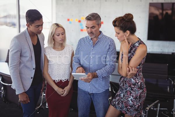 Businessman explaining to team over digital tablet Stock photo © wavebreak_media