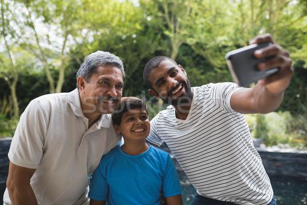 Szczęśliwy rodziny parku wraz niebieski Zdjęcia stock © wavebreak_media