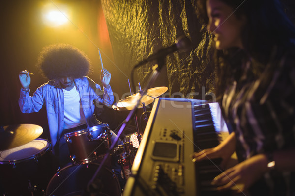 Female musician playing piano with drummer in night club Stock photo © wavebreak_media