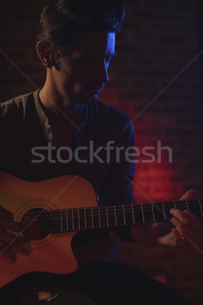 Male guitarist playing guitar in nightclub Stock photo © wavebreak_media