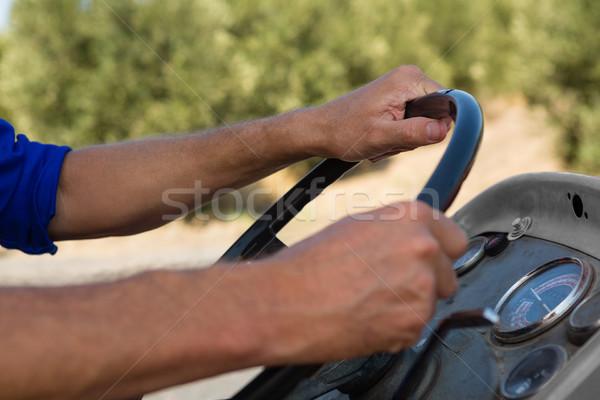 Mão trabalhador condução trator mulher Foto stock © wavebreak_media