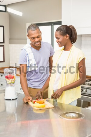 Smiling mother and daughter preparing cookies in kitchen worktop Stock photo © wavebreak_media