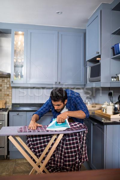 Man ironing shirt while standing in kitchen Stock photo © wavebreak_media