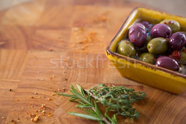 Marinato olive erbe chili contenitore tavola Foto d'archivio © wavebreak_media