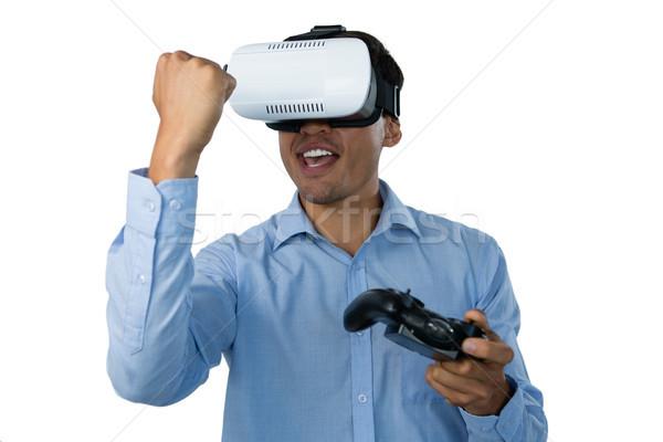 Felice imprenditore occhiali pugno giocare videogioco Foto d'archivio © wavebreak_media