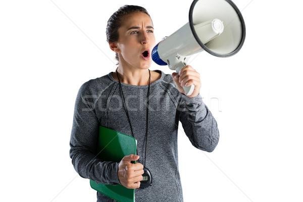 Feminino rugby treinador megafone em pé Foto stock © wavebreak_media