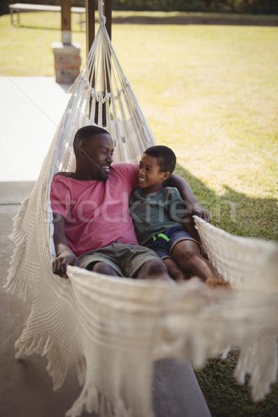Mosolyog apa fia megnyugtató függőágy kert gyermek Stock fotó © wavebreak_media