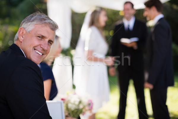 Portrait of man smiling in park Stock photo © wavebreak_media