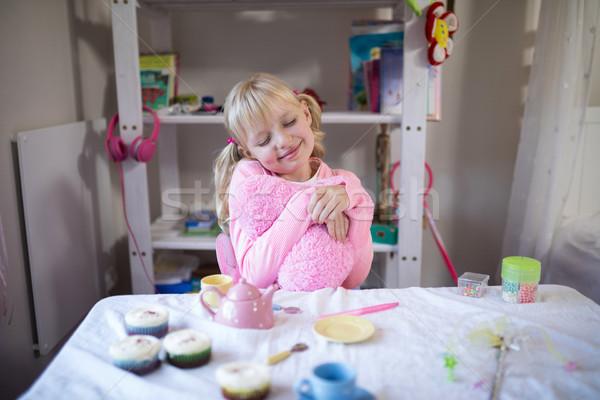 Cute девушки играет игрушку кухне Сток-фото © wavebreak_media