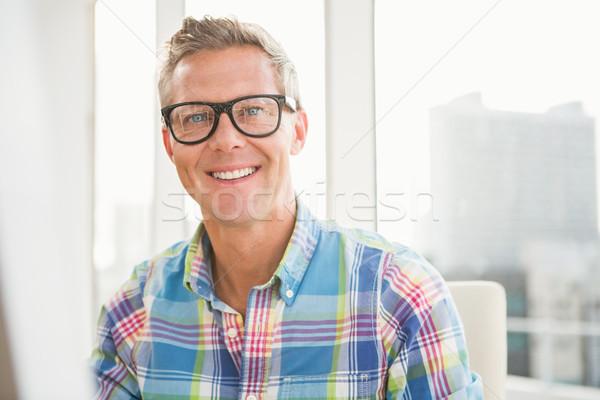 Casual designer smiling at camera Stock photo © wavebreak_media