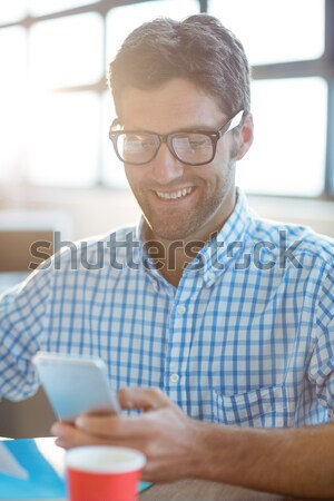 Smiling casual businessman using laptop Stock photo © wavebreak_media