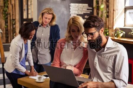 счастливым пару говорить сидят кофейные чашки меню Сток-фото © wavebreak_media