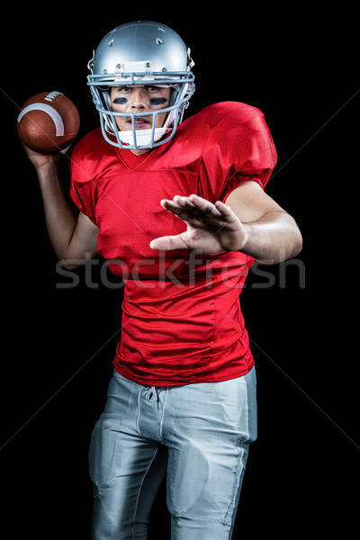 Sportsman throwing American football while playing Stock photo © wavebreak_media