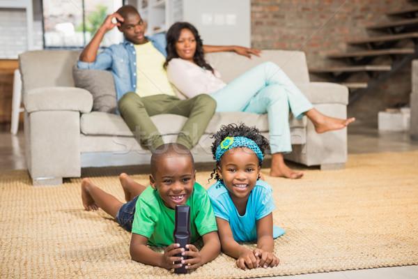 Happy siblings lying on the floor Stock photo © wavebreak_media