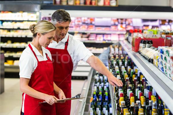серьезный коллеги буфер обмена супермаркета бизнеса женщину Сток-фото © wavebreak_media