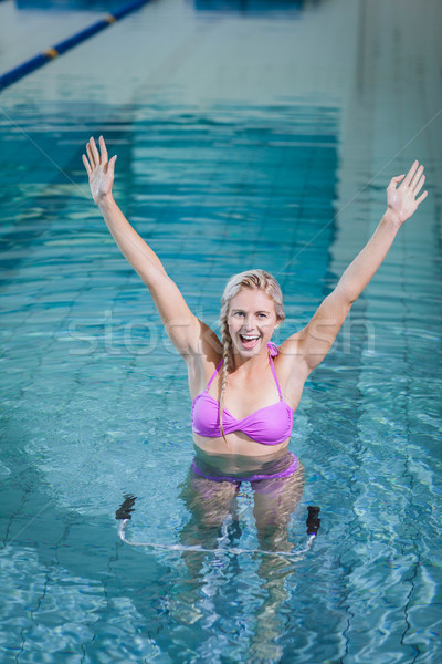 Fit woman doing underwater bike with raised arms Stock photo © wavebreak_media