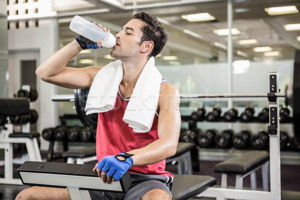 красивый мужчина питьевая вода сидят скамейке спортзал воды Сток-фото © wavebreak_media