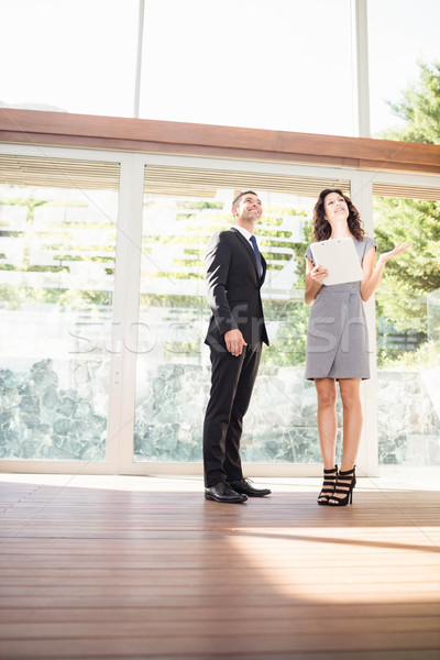 Real-estate agent showing young woman new home Stock photo © wavebreak_media