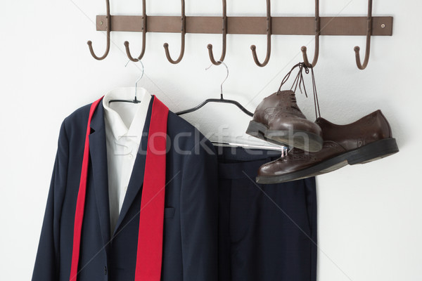 Close-up of full suit and shoes hanging on hook Stock photo © wavebreak_media