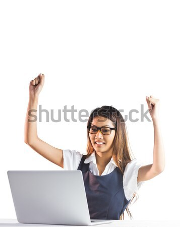 Stock photo: Happy businesswoman using laptop and raising arms