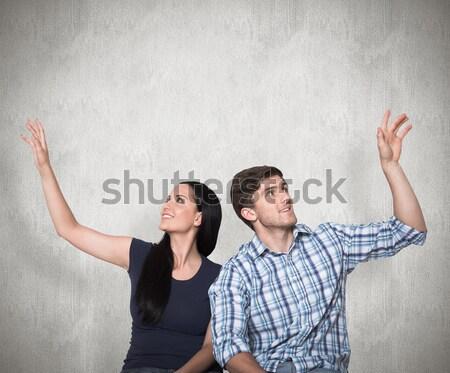 Happy young couple lying on floor looking up Stock photo © wavebreak_media