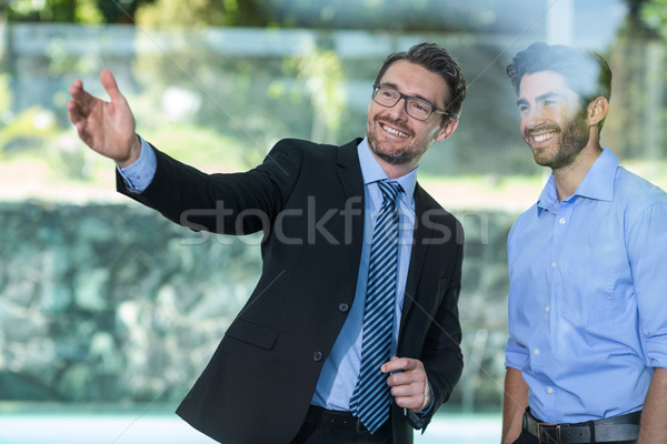 Real estate agent showing property to a man Stock photo © wavebreak_media