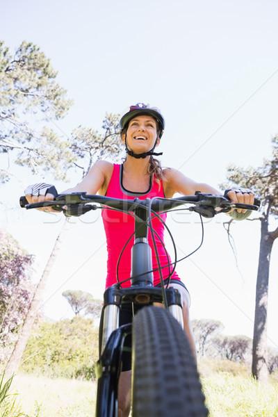 улыбающаяся женщина Велоспорт женщину счастливым природы Сток-фото © wavebreak_media