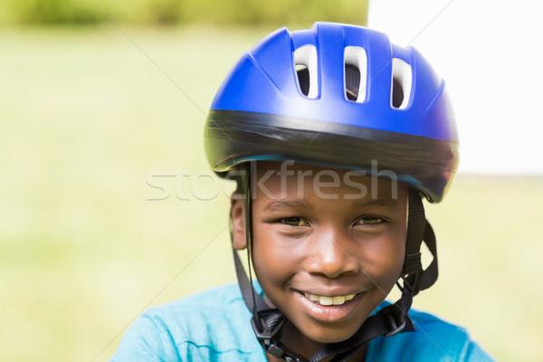 Fiatal srác visel sisak park gyerekek fű Stock fotó © wavebreak_media