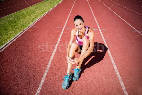 Portrait of female athlete sitting on running track Stock photo © wavebreak_media