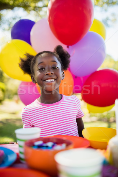 Portrait of cute girl smiling during a birthday party Stock photo © wavebreak_media