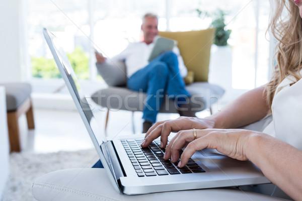 MIdsection of woman with laptop by man using technology Stock photo © wavebreak_media