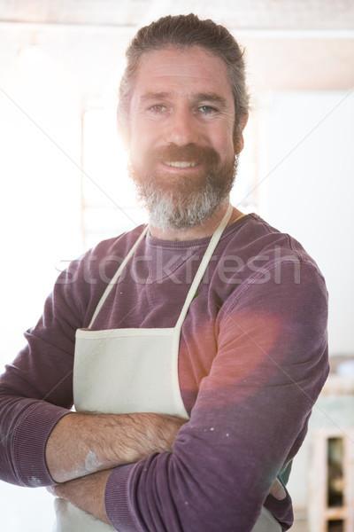 Boldog férfi áll cserépedények műhely keresztbe tett kar Stock fotó © wavebreak_media