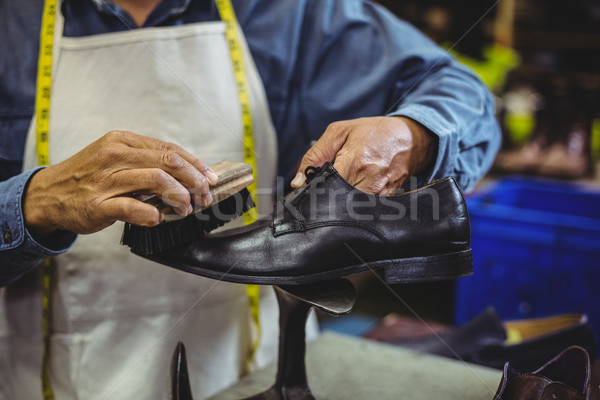 Shoemaker polishing a shoe  Stock photo © wavebreak_media