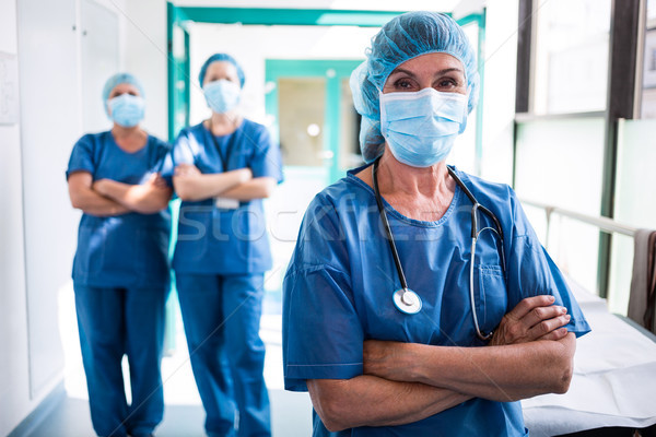 Stock photo: Portrait of surgeon and nurses standing with arms crossed