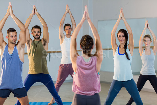 Instructor taking yoga class Stock photo © wavebreak_media